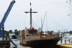"""The """"Good Fortune"""" has the first of three Custom Built Fiberglass Masts set by crane. Starting to look like a Pirate Ship!"""